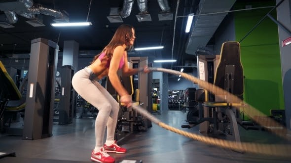 Thumbnail for Battle Ropes Session. Attractive Young and Athletic Girl Using Training Ropes in a Gym