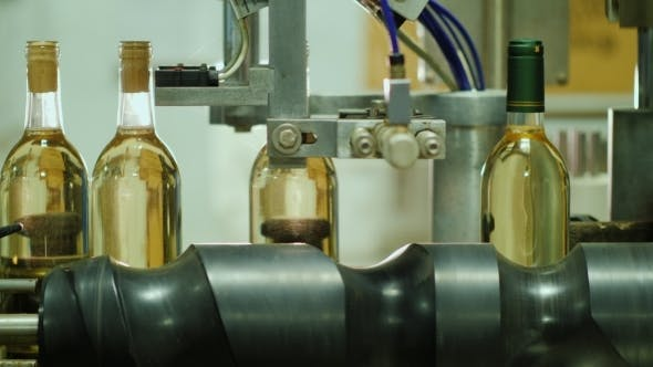 Thumbnail for Moving on the Conveyor Are Bottles of Wine. Production of Wine at the Winery