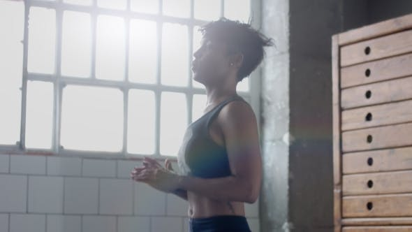 Thumbnail for Young Fit and Tone Up Woman Doing Heating Before a Fitness Workout in Sunny Loft