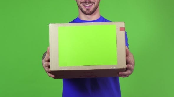 Thumbnail for Deliveryman Holding Out Copyspace Cardboard Box To the Camera