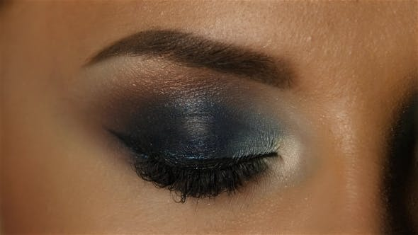 Thumbnail for Girl with an Evening Makeup Closes and Opens Eyes