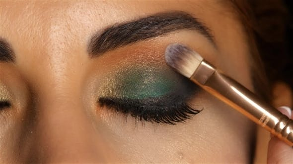 Thumbnail for Girl with Evening Makeup with Closed Eyes, Makeup Brush Tints Eyelid