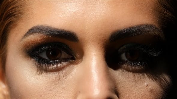 Thumbnail for Girl with Make Up, Face Creams Are Made Up and Beautiful Brown Eyes