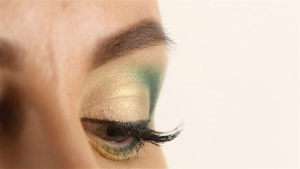 Thumbnail for Girl with Bright Make Up, Gray Eyes Open and Closes