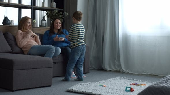 Thumbnail for Happy Family with Child Relaxing in Domestic Room