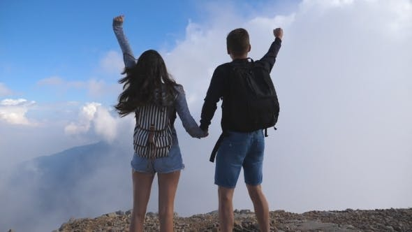 Thumbnail for Man and Woman Standing on the Edge of Beautiful Canyon, Victoriously Outstretching Arms up