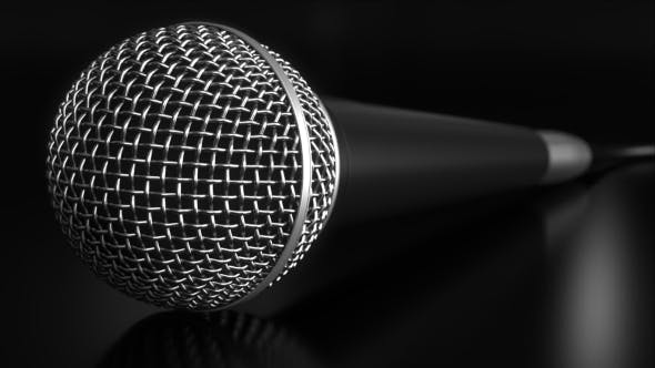 Thumbnail for Microphone Against Black Background