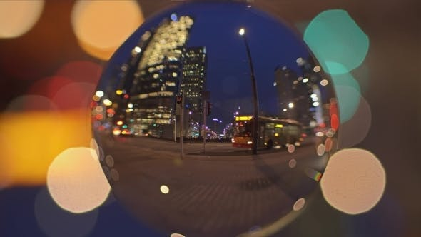 Thumbnail for City Street View in the Evening As Seen Through the Glass Ball