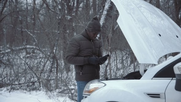 Thumbnail for Man with Broken Car in Wintertime