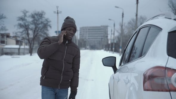 Man Calling Car Service on Remote Road