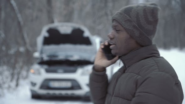 Cover Image for Man Talking with Helpline Having Broken Car