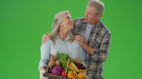 Thumbnail for Couple of caucasian mid aged people looking at fresh vegetables