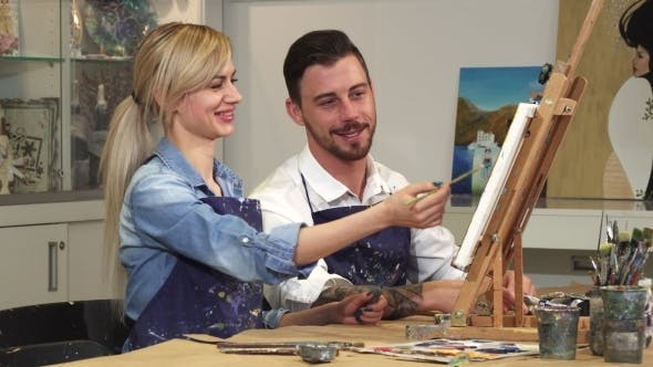 Thumbnail for Loving Young Couple Enjoying Working on a Painting at the Art Studio Together