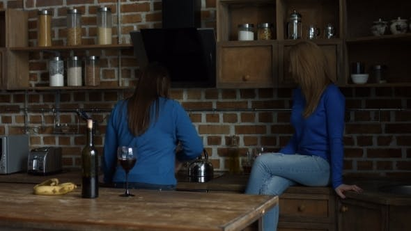 Thumbnail for Happy Female Friends Enjoying Wine in the Kitchen