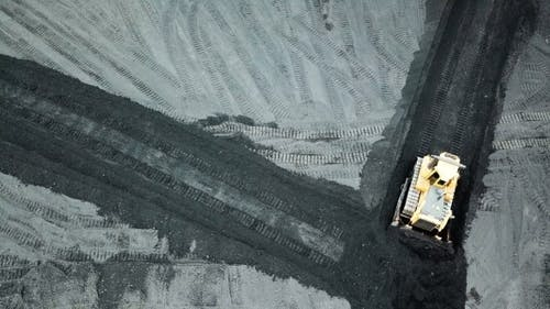Bulldozer Moving Coal