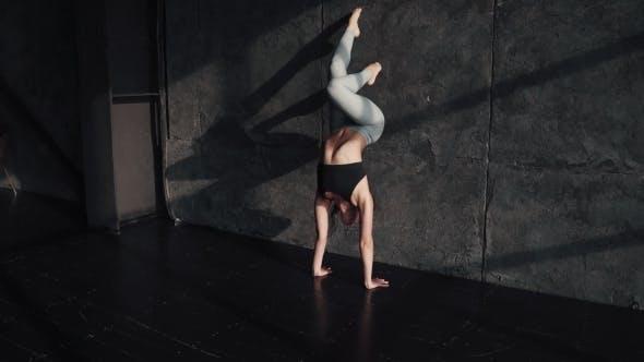 Thumbnail for Girl Doing Yoga. Gymnast Standing on Her Hands