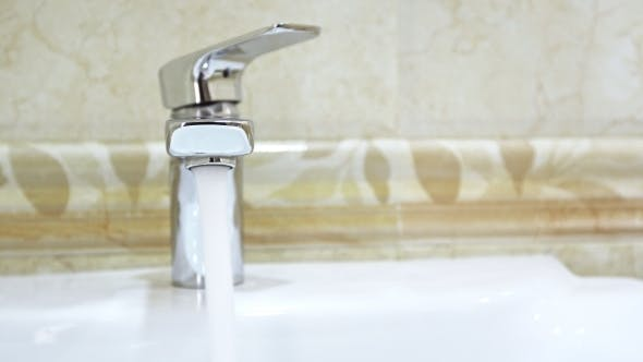 Thumbnail for Open Faucet in Bathroom