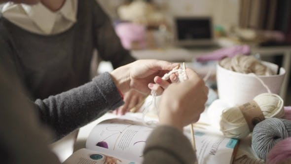 Thumbnail for Female Hands Knitting Needles Woolen Yarn in Home. Woman Learning To Knit