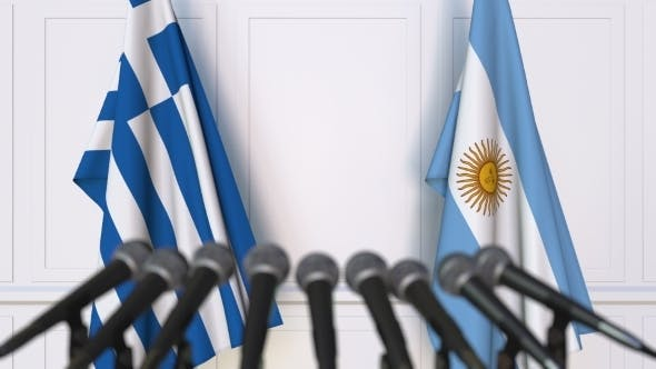 Flags of Greece and Argentina at International Press Conference