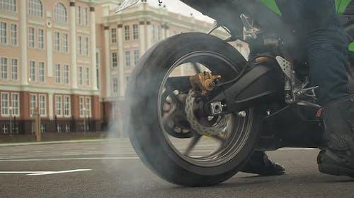 Biker on a Motorcycle Drifts in Smoke