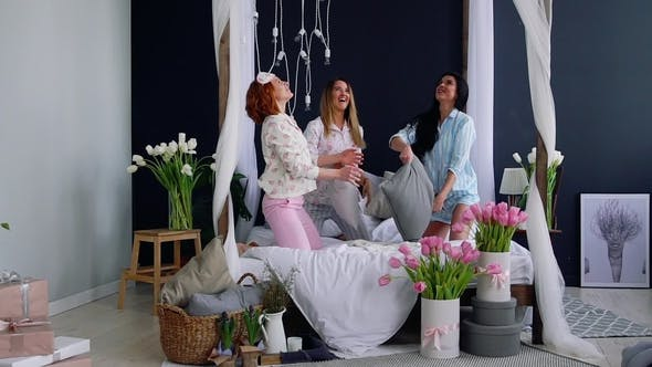 Cover Image for Three Young Sexy Women Pillow Fighting at a Slumber Party in Honor of the Wedding