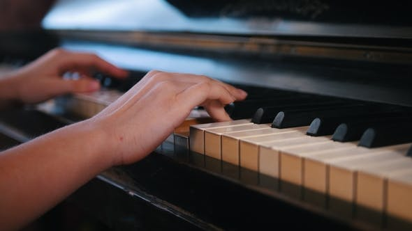 Cover Image for Piano Playing -  Shot - Teen Girl Hands