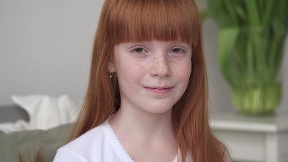 Thumbnail for Little Happy Ginger Girl with Freckles in a White Room