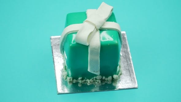 Thumbnail for Bright and Colorful Cake Gift  on a Blue Background