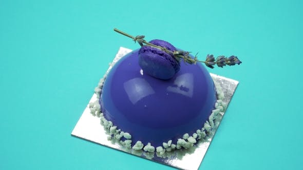 Thumbnail for Bright and Colorful Cake  on a Blue Background. Rotating Top View.