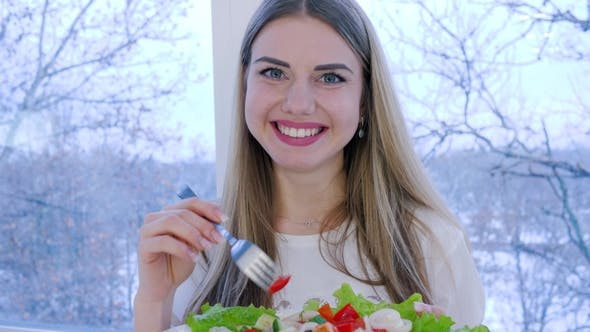 Thumbnail for Portrait of Healthy Woman with Plate of Fresh Vegetable Salad on Background Window