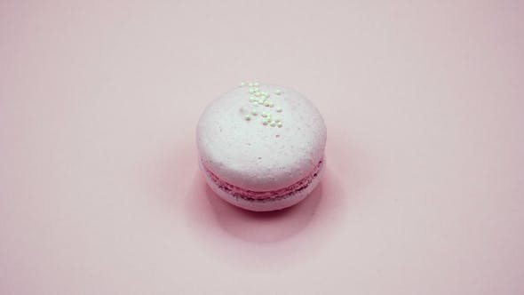 Thumbnail for A Colorful Macaroons are Rotating on a Pink Background