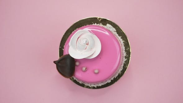 Thumbnail for Bright and Colorful Cake  on a Pink Background. Rotating Top View.