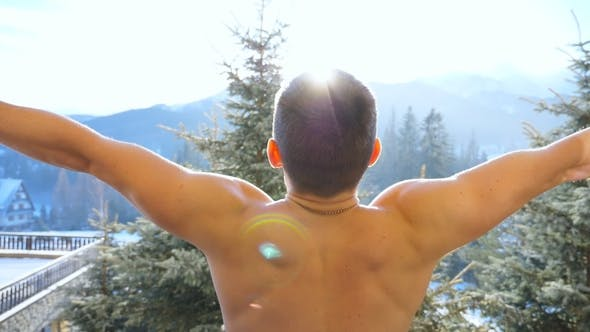 Thumbnail for Unrecognizable Athletic Man Standing on Balcony and Raising Hands During Winter Day Young Guy