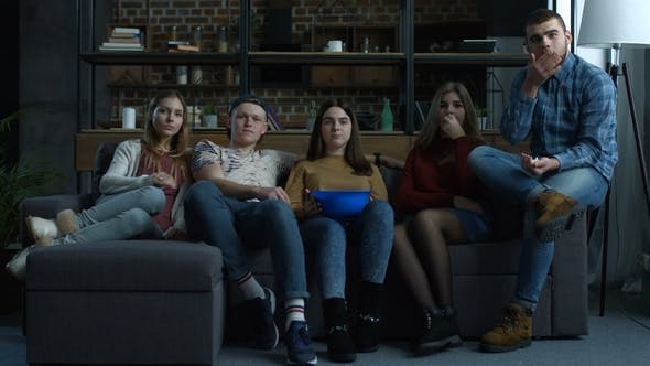 Thumbnail for Group of Teenagers Watch Comdey Movie with Popcorn