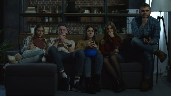 Group of Friends Watching Horror Movie at Home