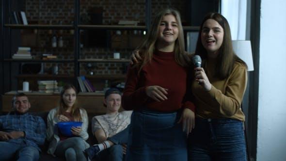 Joyful Girls Singing Karaoke in Domestic Room
