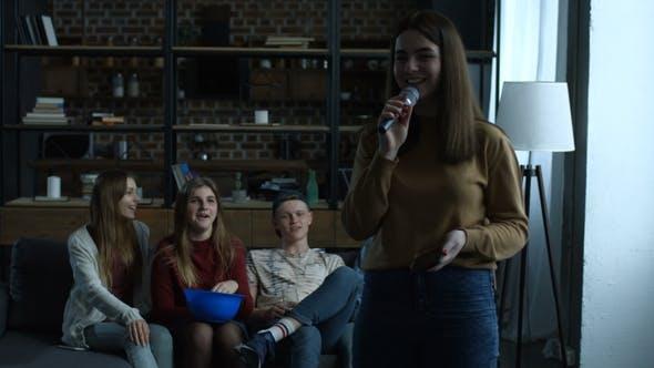 Thumbnail for Cute Girl Singing Karaoke in Microphone at Home