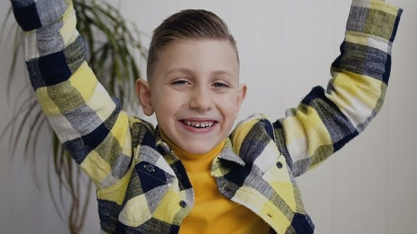Thumbnail for Beautiful Child Blonde Boy with Blue Eyes Smiles and Raises Arms Up Looking Happy, Isolated on White