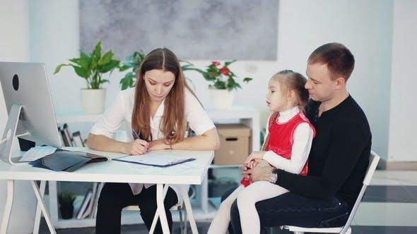 Female Pediatrician Talks To a Little Girl