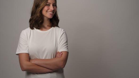 Thumbnail for Smiling Girl in White T-shirt