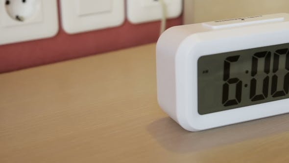 Thumbnail for Electronic Alarm Clock Stands on a Bedside Table in the Room