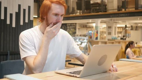 Astonished, Amazed Redhead Beard Man Working in Cafe