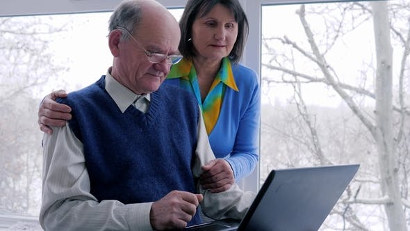 Thumbnail for Home Time, Old Woman with Spouse Look at Computer and Smile on Weekend