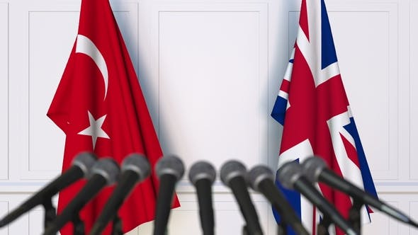 Thumbnail for Flags of Turkey and The United Kingdom at International Press Conference