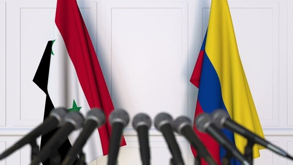 Thumbnail for Flags of Syria and Colombia at International Press Conference