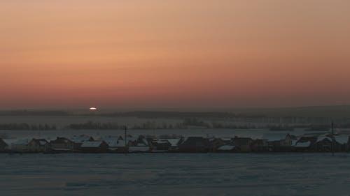 Sunrise Over Frozen Snow-covered Russian Rustic Landscape,
