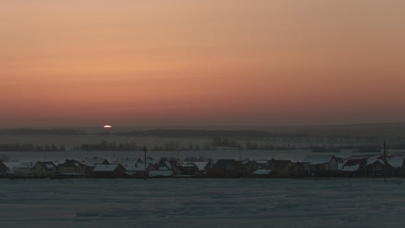 Sunrise Over Frozen Snow-covered Russian Rustic Landscape,