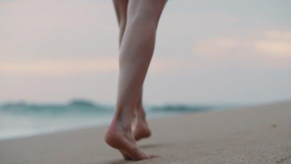 Thumbnail for Female Feet Walking Along the Ocean Shore