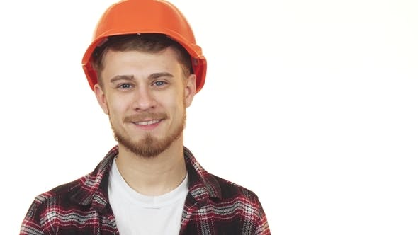 Thumbnail for Happy Handsome Young Construction Worker Smiling Wearing Hardhat