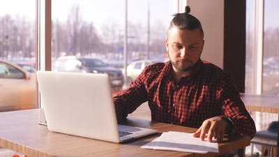 Businessman Working, Businessman in Cafe, Businessman Looking at Documents